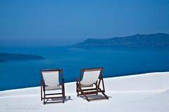 Relax! (images through a lens) Tags: ocean blue sky greek europe chairs santorini greece deckchairs