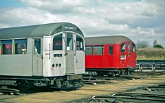 Same Stock, Different Cabs HR scan (Deepgreen2009) Tags: red london classic modern train silver design flat cab 1938 stock tube railway depot conservative aluminium 1959 ruislip undergeround