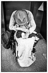 Sleep while stigmatisation (Das Fotoimaginarium) Tags: street old people white man black art monochrome hat sitting sad thomas candid wheelchair fineart homeless fine human reality stigma goffman stigmatisation fotoimaginarium szynkiewicz