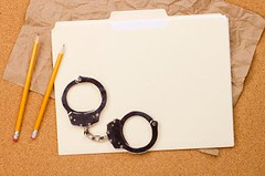 Handcuffs and Folder (hermanjr62) Tags: records metal pencil paper shiny message police custody bondage security file criminal shackles law enforcement copyspace capture convict folder punishment handcuffs arrest prisoner imprisonment crook restraints discipline conviction consequence verdict