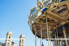 San Sebastian carousel, Spain (Naomi Rahim (thanks for 2 million hits)) Tags: sansebastian donostia espaa spain basque basquecountry 2016 travel travelphotography nikon nikond7200 wanderlust summer bluesky clearsky blue carousel amusementpark ride antique pretty