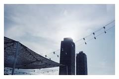 Barcelona (ianloen) Tags: barcelona barceloneta beach building light cloud mjuii olympus mju ii plustek8200i portra160 35mm