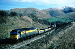 Couple of Oldies.....this working whilst run by the departmental sector, also conveyed the remenents of Speedlink traffic when required.... Just a dusting of snow on the Low Gill fells....6M65 47332 Mossend-Arpley Low Gill 17-06-1991 (the.chair) Tags: 6m32 47332 mossend arpley departmental low gill april 1991