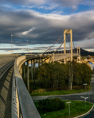 """Bridge in sunset"" (Terje Helberg Photography) Tags: trees city sea sunset water sun light clouds architecture road bridge grass sign sotra bergen bil"