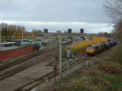 GBRf Loco 66765 with a rake of 18 JGA Hopper wagons stabled on the Up Goods Loop at Broxbourne, with 379 021 in the station and a raft of Rail Replacement Buses over in the car park. 27 11 2016 (pnb511) Tags: westangliamainline broxbourne train diesel locomotive hertfordshire class66 greateranglia class379 electrostar stansteadexpress herts emu electricmultipleunit track carriages catenary loco pointwork station