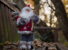 Little Santa in the forest (V Photography and Art) Tags: santa forest bench bokeh backlit trees christmas lantern gifts