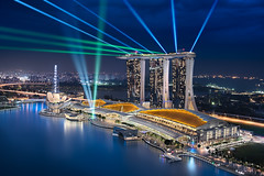 Sapphire Dreams || The Exquisite Marina Bay, Singapore (blame_the_monkey) Tags: skyline architecture asia bluehour city night portfolio singapore travel water marinabay sands sing mba lasers reflections dynamicblending postprocessing colorcorrection lioncity