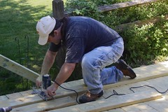 Terry working that router with sawdust a'flyin'. (tjacobs61) Tags: homeimprovement wheelchairs sawdust wheelchairramp