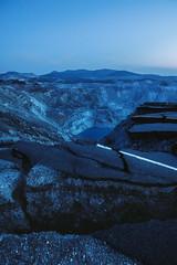 Quebec's Road (Geoff  RT Ficiel ) Tags: road blue trees sunset sky lake canada mountains abandoned rock haze nikon mine bluehour asphalt qc deadend asbestos d700 1635vr