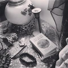 nighttable (LauraSorrells) Tags: stilllife home lamp monochrome scarf beads whimsy object feather earring july jewelry koan story zen bracelet bookmark thecove iphone babyspoon 2013 paulreps zenfleshzenbones instagram intersectionofworlds