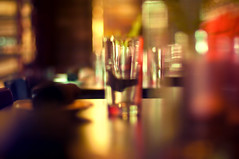 Focus on the Glass (Proleshi) Tags: reflection glass colors table 50mm restaurant glasses nikon dof bokeh ambientlight diner drinks refraction ambient josephs jamal highiso shallowdof alleia 50mm14afs proleshi