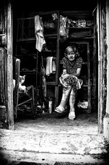 Old lady in shed with cat (Spyros Papaspyropoulos) Tags: street morning light portrait blackandwhite bw woman monochrome lady cat mono chair shadows candid shed streetphotography streetportrait ground greece portraiture crete oldlady oldwoman groundlevel 20mm bwphotography rethymno whiteandblack candidportrait candidphotography streetphotographer streetportraiture candidportraiture sonynex nex6 sonynex6 sel20f28 streethunters