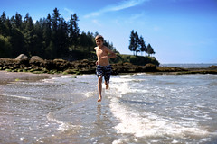 Lewis running in water in Stanley Park. Vancouver, BC (gilbo65) Tags: trip family summer vacation holiday beach water vancouver fun outdoors 50mm bc bokeh britishcolumbia running stanleypark 50mmf14 bonvoyage splashing tripofalifetime canon6d bucketlist bonvoyagecouk
