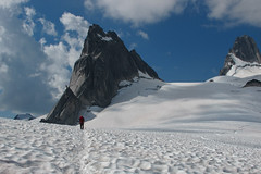 Oleg on the Upper Wovel Glacier during approach to Becky-Chouinard with Pigeon Spire in front of him and South Howser on the right (DmitMF) Tags: mountain canada sport view britishcolumbia extreme scenic peak bugs glacier spire adventure alpine mountaineering mountaineer alpinism bugaboos granit alpinist pigeonspire bugabooprovincialpark southhowsertower uppervowel