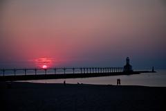 September 9, 2013  7:22 pm (Lynne Dohner) Tags: blue sunset sky lighthouse hot silhouette night landscape skies indiana lakemichigan clear hazy humid indianadunesnationallakeshore abigfave laportecountyindiana lynnedohner