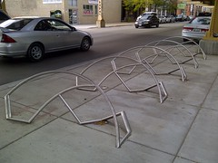 That's a Faaancy Bike Rack, #1 (artistmac) Tags: city urban sculpture chicago abstract streets bike bicycle illinois stainlesssteel steel il rack curved sidewalks stainless bikerack