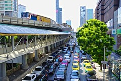 "BTS Skytrain station ""Chong Nonsi"" with train leaving, skywalk below and random traffic jam in Sathorn, Bangkok, Thailand (UweBKK (α 77 on )) Tags: city trees urban building cars public station architecture train buildings thailand asia traffic bangkok sony transport rail southeast alpha dslr publictransport jam skytrain 77 bts skywalk sathorn pubtrans chongnonsi earthasia"
