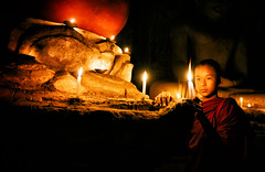 Lighting Candles (Michael S Liu) Tags: candles figures praying lighting statue buddah bagan candlelight building temple myanmar monks wideangle children buddhism
