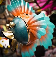 Prize catch (buddah1888) Tags: tropicalfish metalsculpture vibrant vibrance market sale bokeh bauble art buddah1888 canon eosm fun glasgow scotland street vividandstriking