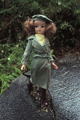 Birthday Present #3 (DeanReen) Tags: vintage mod active sindy doll titian red head redhead pale lips blue eyes green trench beret brown boots yellow scarf buttons belt white raining nature garden concrete pebblecrete crack wild fashion 44344 barbie rain wet moist storm outdoor