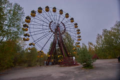 Pripyat Amusement Park (Chernobyl Exclusion Zone)_4 (Landie_Man) Tags: none pripyat chernobyl ionising radiation radioactive fair fairground amuse amusements amusement park may day parade soviet union ussr cccp disused abandoned forgotten left sad never opened ran communism communist fun ferris wheel bumper cars dodgems swing ride swings nature reclaim redstar red star cliche clche