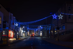 High Street (Roger.C) Tags: chepstow christmas wales wfc evening urban illuminated dark d610 50mm highstreet nikon nightshot nocturnal monmouthshire town decorations southwales longexposure detail