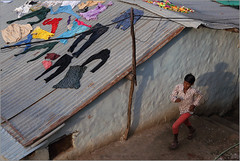 forms, omkareshwar (nevil zaveri (thank you for 10 million+ views :)) Tags: zaveri young man boy men run running people aerial view roof cloths drying colours colors red pink black green slum omkareshwar pradesh mp india madhyapradesh madhya photography photographer images photos blog stockimages photograph photographs nevil nevilzaveri stock photo pattern house home shadow sunlight light