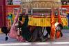 A Playful Prayer (ZeePack) Tags: people street girls children fun play canon india 5dmarkii ladakh buddhist leh prayerwheel jammukashmir milestone milestoneenterprise milestoneenterprisein