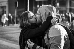A Kiss Is Just A Kiss (Leanne Boulton) Tags: monochrome people depthoffield outdoor urban street candid portrait portraiture streetphotography candidstreetphotography candidportrait streetlife man woman male female boy girl face faces facial expression look emotion feeling atmosphere mood kiss kissing love romance loving romantic couple tone texture detail bokeh bokehlicious natural light shade shadow city scene human life living humanity society culture canon 5d canoneos5dmarkiii ef2470mmf28liiusm black white blackwhite bw mono blackandwhite glasgow scotland uk