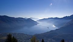 View over Lago Maggiore (wirsindfrei) Tags: lago maggiore lagomaggiore locarno schweiz suisse switzerland ticino nature landscape blue nikond60 nikon natur lake see dust nebel nebelschwaden mountain sky outdoor cloud