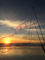 Sunset in a bubble (Jason Rosenberg) Tags: beach bubble sunset colors sky clouds reflection carlsbad california encinitas moonlightbeach coast coastal waves water sea goldenhour