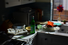 Breakfast Dishes (MPnormaleye) Tags: kitchen bottle sink counter food plates sweet35 lensbaby 35mm bokeh blur composition lowlight