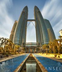 TwistyTwins (draken413o) Tags: morning travel fountain architecture skyscrapers distorted petronas towers cityscapes twin malaysia tall kuala hdr klcc futuristic suria lumpur destinations vertorama oloneo