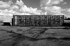 (Delay Tactics) Tags: sky urban bw white black graveyard lines clouds dumpster shadows container explore skip exploration gravel digger ue urbex dsr