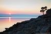 Cunski coastline at sunrise, Losinj Island, Croatia (Ian Middleton: Photography) Tags: ocean morning travel sea vacation holiday seascape reflection tree beach water clouds sunrise island coast rocks europe european cloudy rocky croatia coastline touristattraction adriatic waterscape losinj cunski