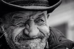 ;-) (Giulio Magnifico) Tags: man smile face look hat closeup beard crazy eyes streetphotography streetportrait streetlife friendly wink gaze popeye udine nikond800e nikkormicro105mmafsvrf28
