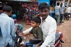Father and son on a bike (Scalino) Tags: india karnataka travel trip badami durga temple fromtherickshaw streetphotography street surprise unposed onspot passingby kid father son bike motorcycle