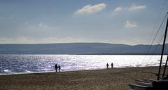 Sandbanks strollers (SteveJM2009) Tags: coast walkers boats masts sandbanks poole dorset uk sun light sand october 2016 autumn stevemaskell