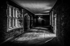 Lighting the corridor (James Waghorn) Tags: sigma1020f456 shadows summer window hamptoncourt palace d7100 blackandwhite silverefexpro2 door dark moody england ghostly