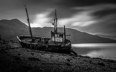 Wrecked (Ian Emerson) Tags: ship shipwreck fishing abandoned derelict decay loch scotland corran blackwhite mountains hills hoya ndx400 clouds moody beach water serene canon 1855mm omot