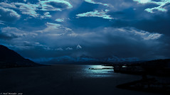 Viking Homeland (Neil. Moralee) Tags: neilmoralee tromso norway water ship ice snow sky colour color dark dim clouds storm stormy fujipix silhouette light pool beam sunlight neil moralee arctic north northern hurtigruten sail sea ocean boat vessel harbor harbour blue