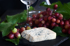 Blue cheese with grape background (Speleolog) Tags: cheese food grape snack wine red appetizer dairy blue ingredient board fresh product background cheeseboard wooden gourmet tasty bluecheese healthy delicatessen vintage french sweet wood drink traditional fruit dessert black slice eat delicious farming culinary plank breakfast different farm space cuisine plate roquefort gorgonzola danablu dorblu stilton german