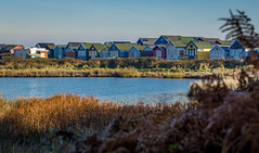 Beach huts in the winter. (Graham H Lock) Tags: beach huts sky blue