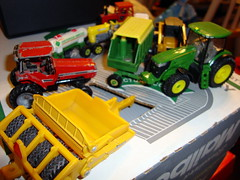 Agricultural Die Cast Toys. (dccradio) Tags: lumberton nc northcarolina robesoncounty diecast tractor wagon foragewagon johndeere roller packer anhydrousammoniatanker skidsteer international red green yellow farmmachinery farmequipment ag agriculture agricultural farm farming model toys