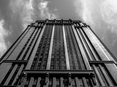 Gotham City (Dinozauw) Tags: parkviewsquare bugis singapore building architecture asia southeastasia gotham lines outdoor structure bw blackandwhite monochrome monotone batman clouds sky dramatic windows exterior shadows linear rows mzuiko17mmf18 facade perspective naturallight urban