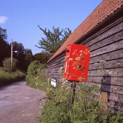 Roadside red (Nodding Pig) Tags: kingstonseymour yatton northsomerset england greatbritain uk 2016 northmarsh postbox red 0048002 film scan transparency fujichrome provia100f mediumformat 120 bronica sqa zenzanon 80mmf28s