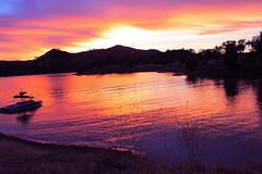 Sunset. (Ashlee Summer) Tags: ocean pink blue light sunset red orange lake color water colors yellow clouds sunrise landscape boats lights boat warm boating