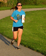 Squirrel Delivery (FrogBum) Tags: girl spring squirrel michigan runners jogger clintontwp clintonriverspillway