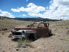 Cruisin' (snappytiger) Tags: old sky mountains newmexico west abandoned car clouds rockies rust ruins decay prairie plains elizabethtown