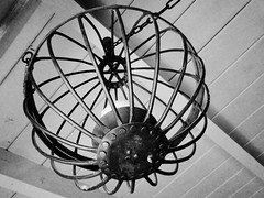 itself it curls in... (Star, LaikazEyes: zazzle.com/mbr/23801218132) Tags: blackandwhite bw blancoynegro wire rivets candle circles cage bn ceiling chain slats hanging fullframe uncropped beams holder dsc07796 cancelabra laikazeyes